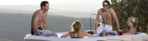 Four people enjoying Bullfrog Spa in a Mountain setting
