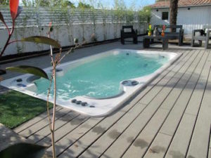 AquaSport 14fX Swim Spa In Backyard Deck in Maine