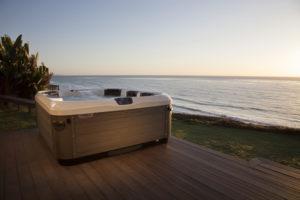 Bullfrog Spas A-series A8 shown on deck overlooking ocean