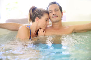 Labor Day Hot Tub Sale Portland Maine - Couple Relaxing in Bullfrog Spa