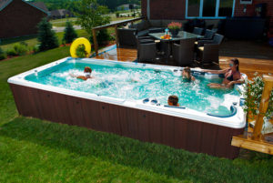 HydroPool AquaSport swim spa in Backyard